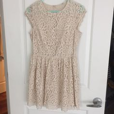 Perfect off white summer dress! Cute lace design with button up back and side zipper. Perfect for any occasion, especially summer weather. The size tag was cut off but it is size 6. This dress also comes in a dark blue. H&M Dresses