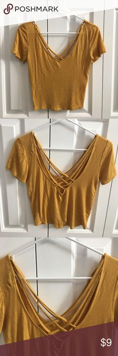 Mustard Yellow Strappy Crop Top Timing mustard yellow strappy crop top purchased from Q.  Size small, fits more like an XS. Cross cross straps on front and back. Barely worn, In good condition!  ✨Make me an offer!! ✨10% off bundles of 2 or more items! Timing Tops Crop Tops