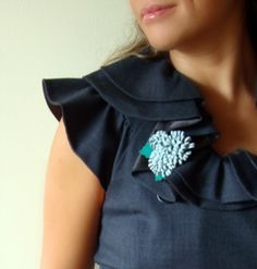 Leather blue brooch