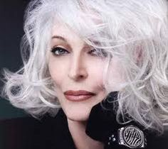 Carmen Del'Orifice.  In her 80's and still modeling. This woman is truly a super model in my opinion.