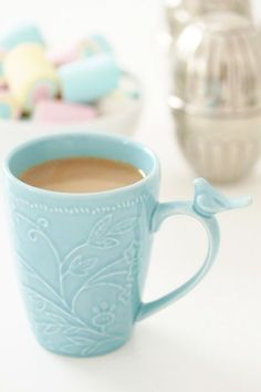 So cute!! - Little birdie perches on the handle of a pretty robin's egg blue (appropriate) coffee mug.