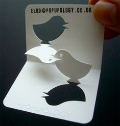 is this a mama bird feeding a baby bird? what kind of business card is this??
