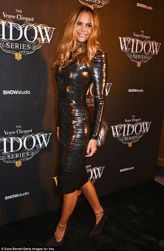 That's not very scary! Elle Macpherson shows off her svelte figure in a tight black dress ...