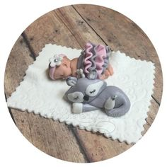 "Fondant baby shower cake topper includes 1 Fondant baby 2 1/2"" long in fondant skirt. Fondant grey Fox 1 4"" blanket FAQ Please read prior to purchase. Thanks! :~) ~PLEASE allow 5-10 business days for"