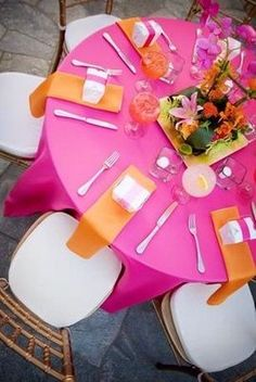 Pink and orange table setting.