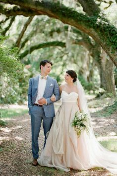 Adrien donned a blue Suitsupply outfit, while his bride glowed in a custom gown by Carol Hannah. Layers of champagne and blush linens created her ethereal flowing skirt, which fit perfectly into the idyllic landscape of Magnolia Plantation.