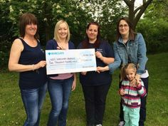Myself and helen from autism wishes presenting the wrexham branch of the nas with a cheque
