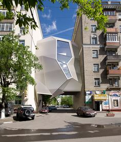 Moscow architects Za Bor imagine office space that hangs in the gaps between buildings.