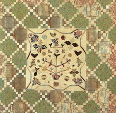 The fabrics in the central area date from the 1820s, whilst the outer pieced squares frame dates from the 1840s. There is a cross stitched name and date 'I (heart shape) M March 8 1844'.