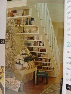 built in bookshelves under stairs...very cool...