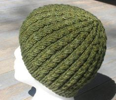 A unisex cable patterned hat in three sizes (Child's, Adult Small, and Adult Large) with two alternate brim treatments.