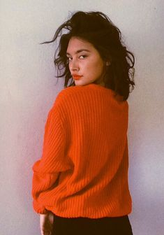 Like the style - oversized orange sweater and tousled hair.