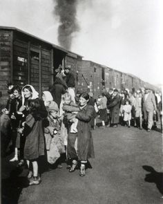 Jews boarding a train to Treblinka, which was an extermination camp. The sole purpose of the camp was the destruction of human life.