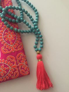 Our unique and colorful malas are perfect for meditation and for wearing every day. 108 turquoise Howlite beads Gold-toned lotus guru bead Hand-cut cotton tassel tied off with gold colored thread Features hand-knotted detailing on bottom of mala Hand made in our San Francisco, California worksop