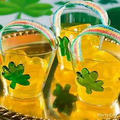 Personal Pots o' Gold:  Use your favorite Jell-O shot recipe and a mini muffin pan to create adorable spiked Jell-O coins. Sour Power Belts serve as delicious edible rainbows. Serve in clear tumblers decorated with fun shamrock stickers