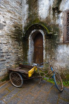 Tricycle and wall; Xingping, China.