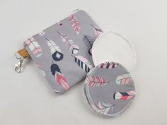 Small zipper pouch with reusable breastfeeding nursing pads set, gifts for her, stocking fillers, unique baby shower gift, feather print Nappy Wallet, Modern Cloth Nappies, Small Zipper Pouch, Nursing Pads, Unique Baby Shower Gifts, Cosmetic Pouch, Waterproof Fabric, Feather Print, Coordinating Fabrics