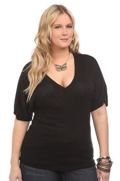 I prefer V-necks as they accentuate my favorite body part--my ta-tas!  It also doesn't hurt to wear black as it's quite slimming.  I love to wear dark purples, browns, grays, and blues, as well, even if the color is only located in the areas that need a little slimming visually.