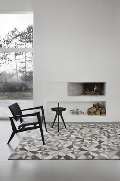 T.D.C   Leather geometric rug by Woven Ground