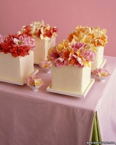 mini cakes topped with a ton of bright flowers