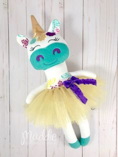 Floral Unicorn Doll These adorable creations make wonderful baby shower, birthday and Christmas gifts! ⭐️Item Details⭐️ This sweet girl measures approx 18 from the tips of her toes to the top of her horn. She comes with a removable Gold tutu skirt. She is truly one of a kind! She is