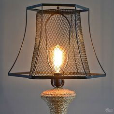 Do you need an idea for a lamp makeover? See how I revamp an old lamp using some rope and a Dollar Store trash can.