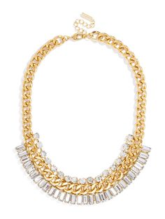 An oversized gold curb chain edges up a classic silhouette--the addition of crystal baguettes and solitaires makes it ultra glam.