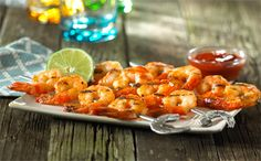 Marinating in a tangy barbecue sauce brings something special to this simple shrimp dish.