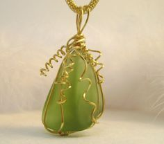 Green frosted glass wire wrapped pendant by FeathersnThingz, $22.00