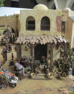 lots of great details Christmas In Italy, Christmas Holidays, Miniature Houses, Miniature Dolls, Christmas Nativity Scene, Nativity Scenes, Fontanini Nativity, Ceramic Houses, Holiday Tables