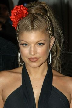 Fergie, 2003Fergie always wowed, especially with her twists and reverse plaits. Lesson of the day: Pop a flower in your 'do to channel her 2003 look.  #refinery29 http://www.refinery29.com/2016/08/121425/vma-best-beauty-moments#slide-12