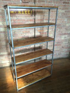 Custom bookshelf made from reclaimed wood and square steel tubing