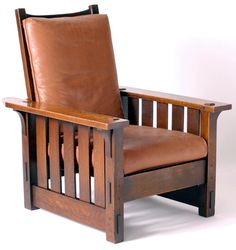 """Morris Chair"" by Gustav Stickley (1902).  The Craftsman style was a reaction to the machine age of the late 1800s.  Stickley and his contemporary 'craftsmen' promoted hand crafted homegoods like this chair.  The craftsmanship is seen in the design: mortise and tenon joints, pegs, and the use of finely-grained, quartersawn oak."