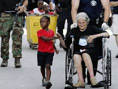 19 Photos Sure to Make You Cry--Five-year-old Tanisha Blevin holds the hand of Nita LaGarde, 105, during the evacuation after Hurricane Katrina. There is no age or size limits for angels as you can see.
