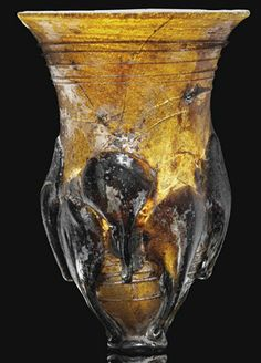 AN ANGLO-SAXON AMBER GLASS CLAW BEAKER   CIRCA SECOND HALF 6TH-7TH CENTURY A.D.