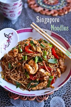 singapore noodles 150g/5 ozs dried rice vermicelli noodles  150g/5 ozs fresh prawns shelled (or 300g/10ozs unshelled prawns)  200g/7ozs chicken breast fillet, thinly sliced  1 tablespoon cornflour or cornstarch  1 teaspoon soya sauce  1 teaspoon white sugar  1 teaspoon Chinese rice wine  1/2 teaspoon salt  Oil for frying  4 tablespoons curry powder  1 tablespoon ginger  1 onion, thinly sliced  1 medium sized red capsicum, thinly sliced  1 medium carrot  1 cup shredded cabbage  1 cup bean…