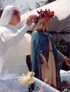 Crowning the Virgin statue We did this every May .