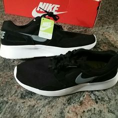 Nike athletic shoes black * white * gray Brand new never worn.  Men's size 9.5 which fits women's size 11 Nike Shoes Athletic Shoes