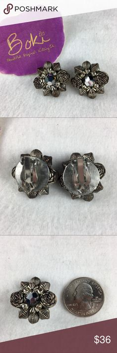 Vintage Rose and Black Jewel Lever-back Earrings Truly unique set of vintage earrings in beautifully pristine shape. Faux marcasite-type black gem in center picks up light for a bit of sparkle in otherwise neutral design. Deeply detailed metal worked roses are simply gorgeous. From family collection, stored in smoke free home. See pics for size. Vintage Jewelry Earrings