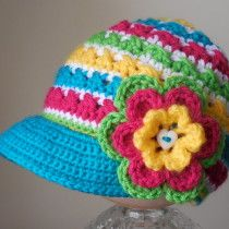 Newsboy Twist-Up hat.  U have to follow several links to get to it but ultimately u end up at craftsy and the pattern is $5.95.