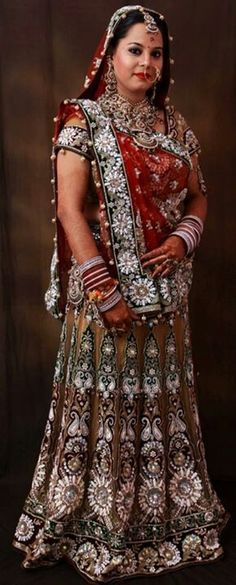 Indian bride in dull gold and red lengha