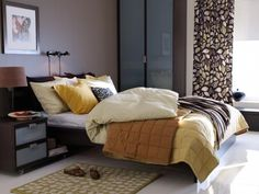 Comfortable bedroom with curtains and wooden furniture
