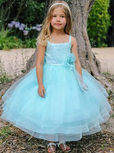 Aqua Sequin Bodice w/ Full Trim Layered Skirt & Bolero Style: Sequins lace bodice with spaghetti straps Matching bolero Full multi layered tulle skirt Removable sash and flower Zipper back Ankle length Tip Top Kids 5662 Girls Communion Dresses, Girls Pageant Dresses, Wedding Flower Girl Dresses, Flower Dresses, Flower Girls, Country Bride And Gent, Layered Skirt, Lace Bodice, Bridal Looks