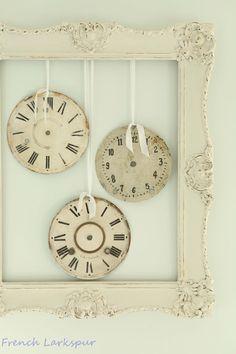 vintage clock faces in old frame