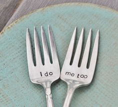 this is a unique idea for the 'wedding cake' .... mismatched vintage forks that are engraved. How easy would it be to go to a thrift store or yard sake to pick these up, and take them for engraving yourself?