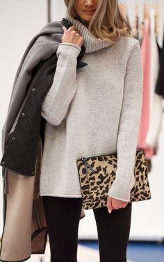 We love a long cowl neck sweater over black skinnies! A leopard clutch completes the look!