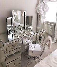 Christian Dior at home with mirrored furniture in this Art Deco-esque scheme