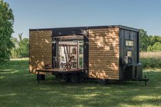 "The Beautiful ""Alpha"" Tiny House on Wheels by New Frontier Tiny Homes - Dream Big Live Tiny Co. Alpha Tiny House, Tiny House Hotel, Best Tiny House, Good House, Glass Garage Door, Sliding Glass Door, Sliding Doors, Tiny Houses For Sale, Tiny House On Wheels"