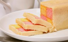 Battenberg cake is said to have been invented in 1884, in honour of the marriage of Queen Victoria's granddaughter, Victoria of Hesse-Darmsadt, to the German prince Louis of Battenberg. Like Coronation Chicken, created for our Queen's coronation nearly 70 years later, it was so popular it never went away.  Picture: Bon Appetit / Alamy