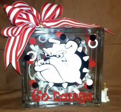 Georgia Bulldog glass block with lights. Contact Julie at for order. All football teams can be created. Vinyl Crafts, Vinyl Projects, Fun Crafts, Georgia Bulldog Wreath, Georgia Bulldogs, Decorative Glass Blocks, Glass Block Crafts, Silhouette Cameo Projects, Crafty